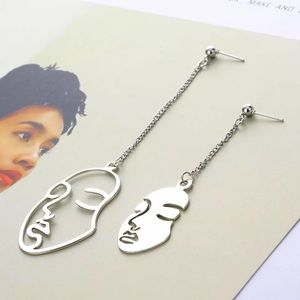 3/$30 🤍 Long Abstract Face Earrings